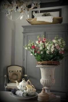 Beautiful colors: Love the oversized urn, the chair, wardrobe/hutch/ and chandelier..