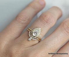 A oneofakind engagement ring featuring a pearshaped diamond
