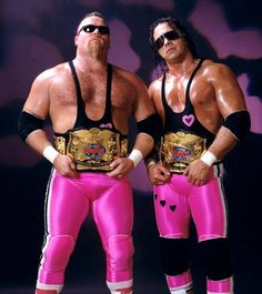 Bret Hart & Jim Neidhart the Hart Foundation as WWF World Tag Team Champions Watch Wrestling, Wrestling Stars, Wrestling Wwe, Wrestling Costumes, Wwf Superstars, Wrestling Superstars, Attitude Era, Wwe Wallpapers, Wwe Champions