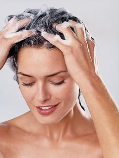 """You probably already know that whole """"lather, rinse, repeat"""" thing can damage your hair. But here's something you may not know: Getting smooth hair can be a whole lot easier if you start styling it in the shower—and avoid sneaky mistakes that cause breakage and flyaways in the long run."""