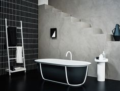 Agape, Cuna bathtub by Patricia Urquiola, Fez taps and Stairs extra by Benedini Associati and Gemma extra by Sebastian Herkner. Learn more on www.agapedesign.it - #agapedesign #bathroom #interiordesign