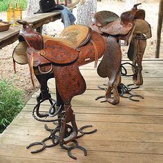 How cool is this!!! An authentic American western saddle that perches above a clever horseshoe base on the leather and metal Authentic Saddle Barstool with a swivel base! It is made in the USA. Each saddle is different!!!