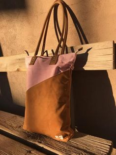 Joplin Tall Tote in Desert visits Taos, New Mexico. Feeling at home in the November sun. Waxed canvas. Two tone. Vegetable Tanned Leather. Large exterior pocket.
