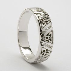 The Aillis which is the Irish version of the name Alice is an elegant version of the ever popular Trinity knot design fashioned in all white gold and enhanced by separating the Trinity knots with rows of glistening diamonds - See more at: Celtic Rings, Celtic Wedding Rings, Beautiful Wedding Rings, Wedding Rings Vintage, Wedding Jewelry, Wedding Bands, Gold Wedding, Elegant Wedding, Romantic Weddings
