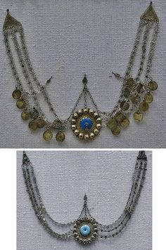 Two traditional 'alınlık' (forehead ornaments) from the Adiyaman-Urfa region.  Ca. 1925.  On exhibit in the Antalya Museum. (Top) silver, gilt silver, turquoise, copper coins.(Bottom) silver and turquoise.