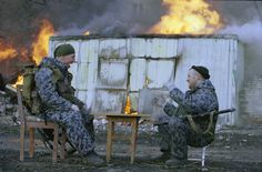 Grozny, Chechnya, January 2000. OMON (Russian Militia special forces) fighters playing draughts. Second Chechen War. [Credit : Yuri Kozyrev]