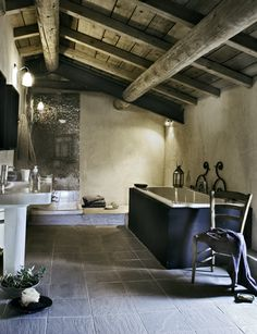french farmhouse. bathroom heaven - mirror-tile shower wall! yeah! (best you have good body image to shower in there!)