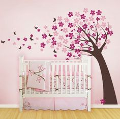 Baby's nursery decal - we reversed the pattern and changed up the colors. White and the darker pink flowers. The wall color is a light and dark lilac color...