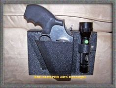 The SAF-Sleeper bed side gun holster with flashlight holder by Nighthawk Protects, is just like the original concealed gun holster, but this design has a flashlight holster also. It is a concealed bedside holster that is a dependable, long-lasting firearm readiness system made from ABS plastic which is known for durability, toughness, and impact resistance. Back plate is an 'L-shaped' bracket that slides between your mattress and box spring for a secure hold. $22.95