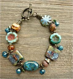 With earrings, bracelet, necklace. Made with crystals, Czech glass, Lampwork glass and bronze metal. This is a one of a kind piece. Enamel Jewelry, Metal Jewelry, Boho Jewelry, Beaded Jewelry, Jewelry Design, Statement Jewelry, Jewelry Ideas, Gemstone Bracelets, Handmade Bracelets