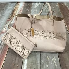 Ralph Lauren tote bag EUC large pale pink tote bag with matching wristlet. Wristlet has a lanyard to attach to the bag or can be used separately. Inside is a soft metallic gold. Perfect spring/summer bag. Perforated detail on bag and wristlet. Ralph Lauren Bags Totes