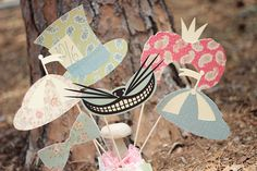 Yes, please! Alice in Wonderland vintage photo booth props.