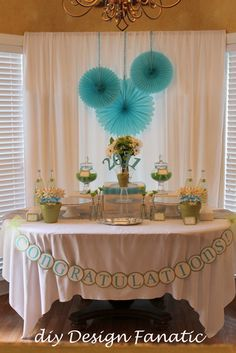 i like the curtain behind the table...make some out of pvc pipes to hide the boring hall walls