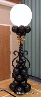 Add a touch of the royal blue and lilac flowers or ribbons.     Lighted Streetlamp Balloon Column