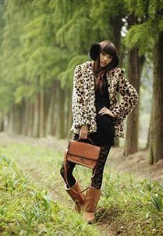 1. Leopard Faux Fur Coat  2. Black Dress  3. Black Patterned Stockings  4. Brown Ugg Boots  5. Brown Purse