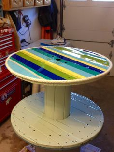 UpCycled rope spool table--such bright colors!