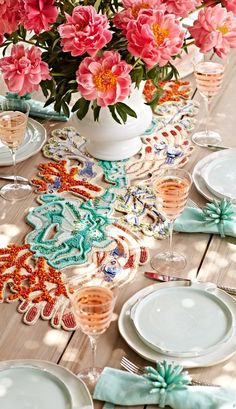 The captivating beauty of one of the seven natural wonders of the world is brought to your table setting with our Barrier Reef Placemat from Kim Seybert.  | Frontgate: Live Beautifully Outdoors