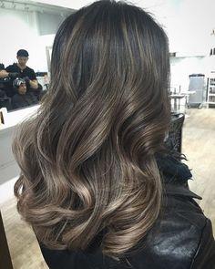 Ashy caramel highlights on black hair