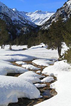 "Sinuous stream in de snowy ""Plateau du Cayan"" in Cauterets, Pyrenean Mountain. Cauterets, Midi-Pyrenees_ South France"