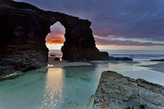 PLAYA DE LAS CATEDRALES (GALICIA): A beach which encapsulates the wild, craggy coastline of Spain's most easterly region like no other. 'Cathedrals Beach' leaves visitors in awe of its gigantic arch-like rock formations and deep caves. Places To Travel, Places To See, Magic Places, Beaches In The World, Spain And Portugal, Spain Travel, Natural Wonders, Strand, Wonders Of The World