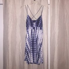 Tie-dye summer dress Strappy blue & white tie dye dress with triangular v cut front, crisscross straps across the back with lower back exposed. Tiny side zipper. Never worn before! Super cute! 100% Rayon Mimi Chica Dresses Mini
