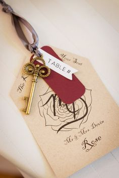 Unique, vintage-inspired escort card idea - skeleton key escort cards with wedding crest {Artful Weddings by Sachs Photography}