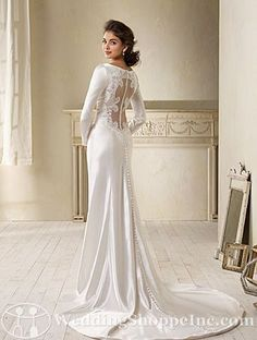Alfred Angelo Bridal Gown 8400 - a stunning satin, sheath style bridal gown with elegant v-neckline and long sleeves, featuring a dramatic open back with lace embellishments, netting , and covered buttons.