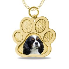 Send us a picture of your doggy.  We photoengrave it on the Paw Pendant.  Choose from Sterling, 10K or 14K.  Memorialize your loving family pet.