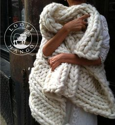 Chunky knit throw cuddled up by the fire