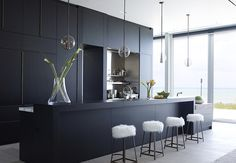 Sleek and Chic Black Cabinets | 30 BLACK KITCHEN CABINETS IN BEAUTIFUL COOKING SPACES | www.elledecor.com #interiordesign #cabinets