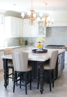 White and marble kitchen with black accents