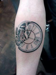 Broken time piece tattoo