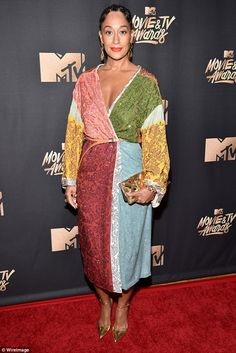 Colours of the rainbow: MeanwhileTracee Ellis Ross arrived in a shimmering dress of multi...