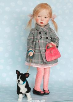 She wears an adorable plaid coat and comes complete with her handmade pin and her adorable needle felted one of a kind dog.