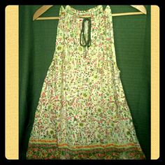 Floral Free people mini dress/ tunic xsmall Gently used Free people mini dress/ tunic Size x-small,  But the style is very forgiving.  Has beautiful hints of green floral and light yellow Straps are adjustable and tie in the front Lightweight fabric great for hot summer days Made in Macau. Free People Dresses Mini