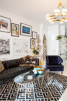 Geometric hide rug, leather chesterfield with fur throw & pop art