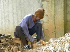 Papa Bamy, (blind brother) breaking rocks for gravel at a Kingdom Hall build in Guinea, West Africa. LOOK AT HIS SMILE :)