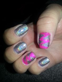 I just did this neat design using painters tape and nail polish... It's easy and anyone can do it!  Just paint your nails any color you like (make sure its dry completely) then cut small triangles and place them on your nails in any style you like...then pick another color and paint over the tape and the nail in an even coat (not too thick)...let dry for a few minutes and then peel the tape off and see your design...apply top coat when done!