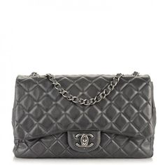 This is an authentic CHANEL Lambskin Quilted Jumbo Single Flap in Grey. This is a stylish Chanel flap bag that is crafted of luxuriously soft diamond-quilted lambskin leather in grey.