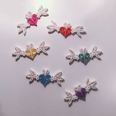 Here is different colours version of this little lovely heart with wings paper quilling decorations, perfect for wedding, birthday party, baby shower, bridal shower decorations or favours or just simply decorations for your lovely room.