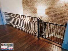 A baby gate and lexan are used in this picture to provide protection for a dangerous stairway and stair railing with climbing feature. Another great install by Safe Baby Childproofing!