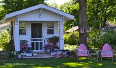 one of the cutest little garden sheds I think I've ever seen.  Click on the photo to see a wintry scene.