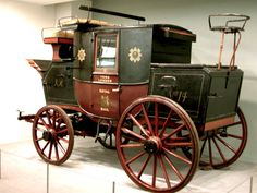 """Mail Coach. The York-London mail coach in the collection of the National Science Museum, London, has """"Royal Mail,"""" """"VR [for Queen Victoria],"""" and """"No. 14"""" painted on its side. Photograph by George P. Landow."""