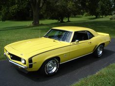 '69 Camaro SS 396 in yellow with black stripes and original Rally Sport wheels