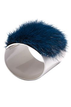 Shop the Trend: A bolt of cobalt adds punch to traditional black and white. Fendi Cuff, $700, 212-759-4646.