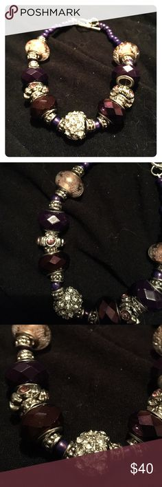 Purple & silver charm bracelet 🔮Handmade in Minnesota🔮 This gorgeous bracelet features small, metallic purple glass beads, small detailed silver beads, large unique charms in various purple hues set in silver, & a silver toggle clasp closure. Offers are welcome 🙂 Boutique Jewelry Bracelets
