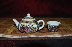 Asian Porcelain Mini Teapot with cup Geisha and Floral design