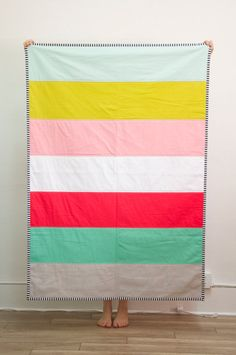 """• a gorgeous, modern color block quilt with seven different colors on the front • a well-sized quilt that isn't just for babies - it's large enough to be an adult sized throw blanket at 42"""" x 62"""" • an"""
