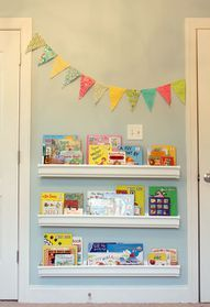 Super cheap way to display books in the classroom - rain gutters! :)