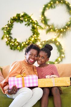 A mother and daughter sitting on a sofa at home sharing Christmas gifts together Christmas Presents, Daughter, African, Sofa, Xmas Gifts, Settee, Couch, My Daughter, Christmas Gifts